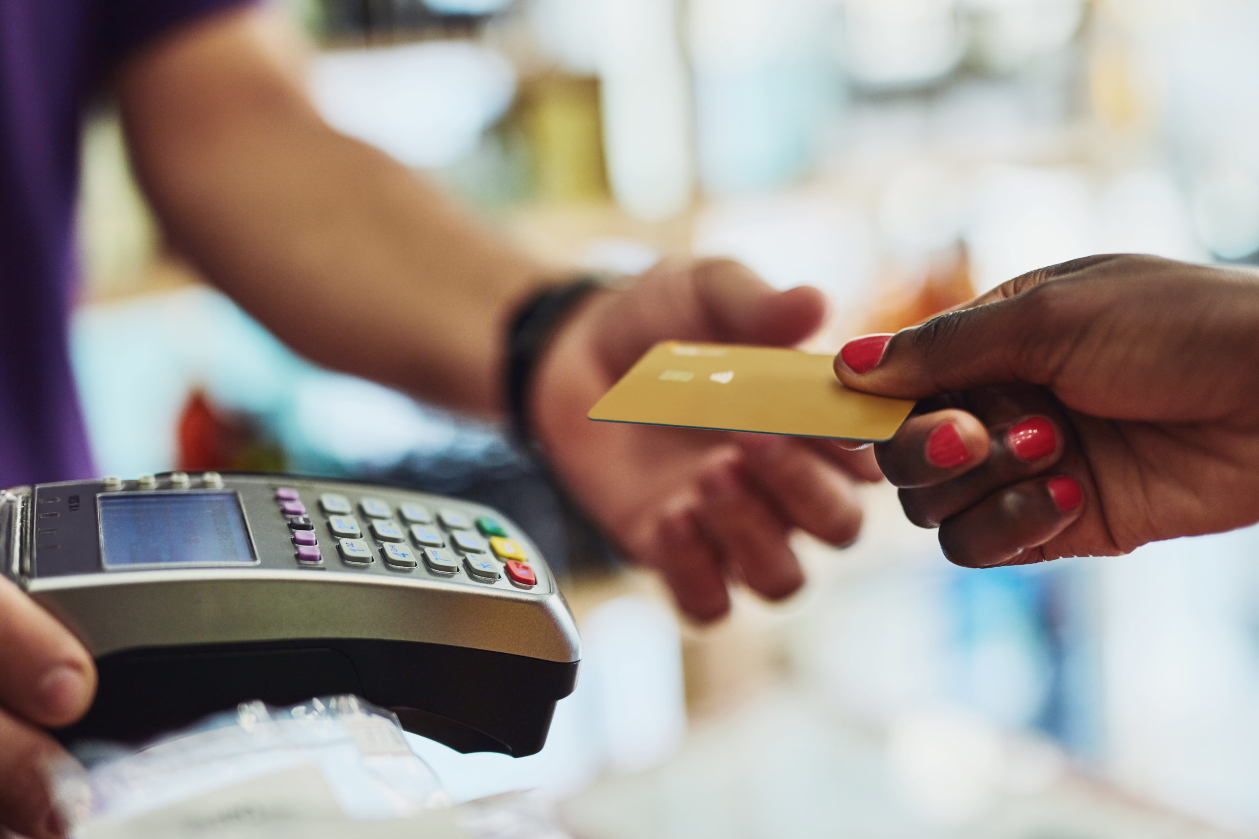 Cropped shot of an unrecognizable customer making payment in a store
